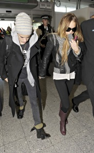 Lindsay and Sam Hold Hands At Heathrow (USA and Oz Only)